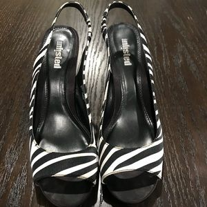 Zebra slingback pumps